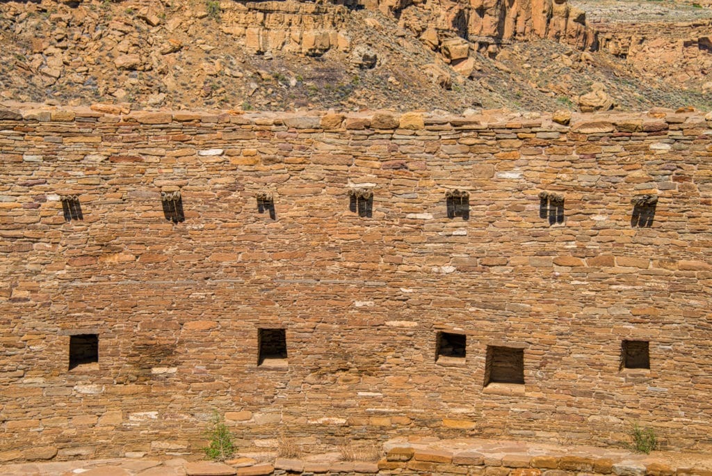 This is a detail of the south-facing interior wall of the Great Kiva at Casa Rinconada, across Chaco Wash from Pueblo Bonito in Chaco Canyon, New Mexico. Featured on the wall are vigas in groups of three and multiple niches. NCAR's High Altitude Observatory postulate that this slightly above-ground kiva was used for astromnomical observations and religeous ceremonies based on its orientation, location, and symmetry.