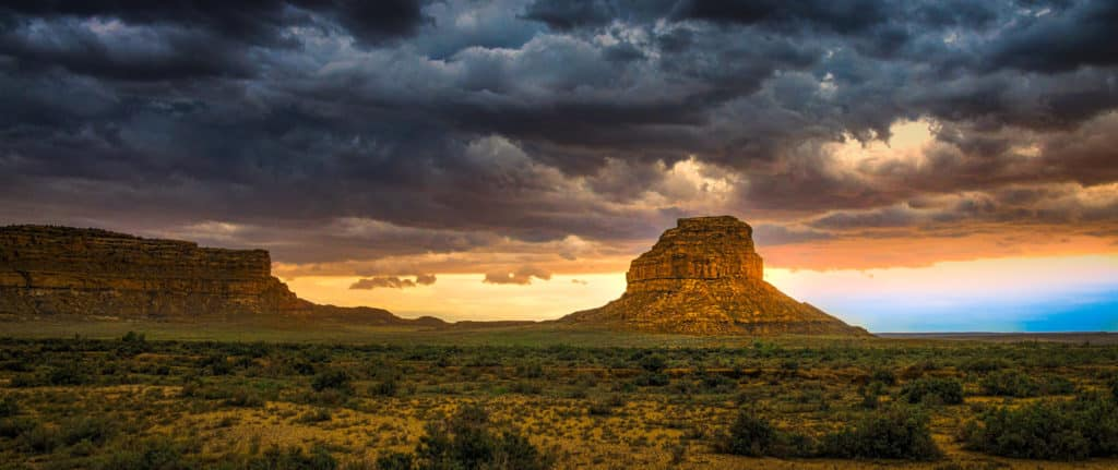 Angry clouds of evening thunderstormshang menacingly above Fajada Butte In Chaco Culture National Historical Park in Chaco Wash, New Mexico.