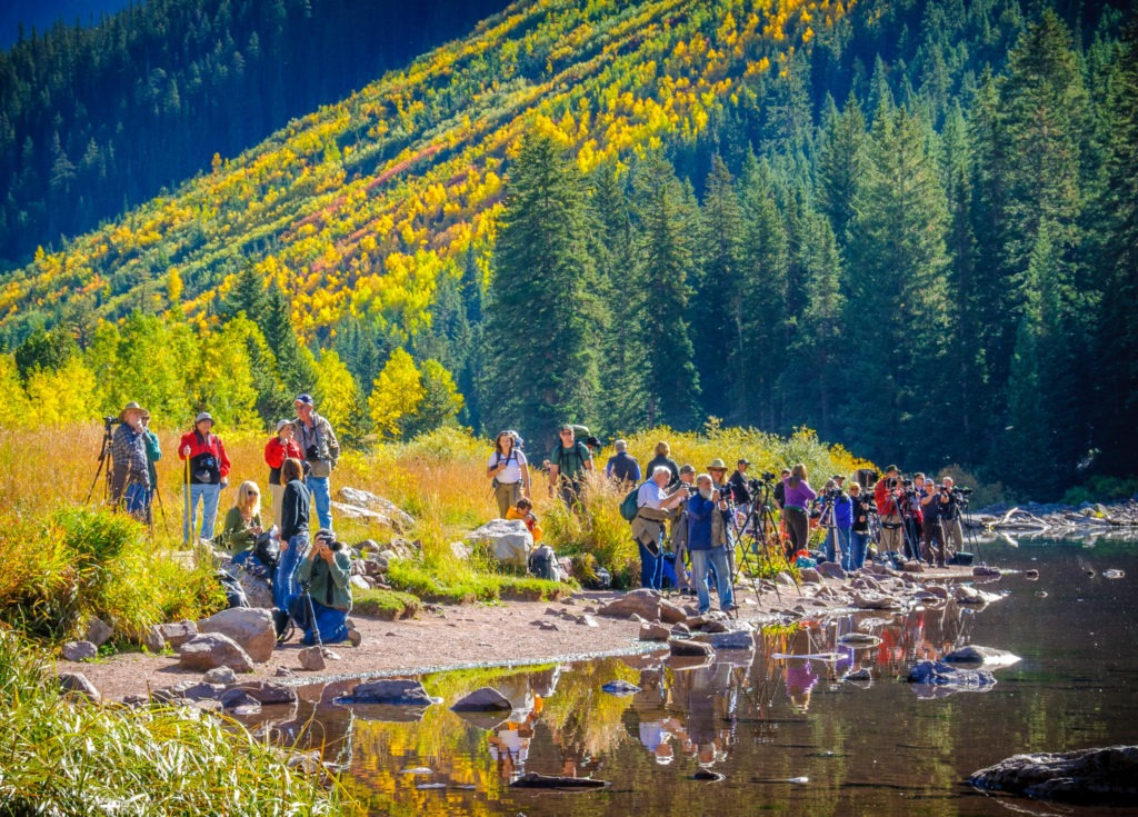 A group of photographers trying for shots of the Maroon Bells in the Maroon Bells Recreation Area near Aspen, Colorado.