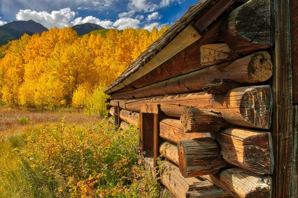 A detail of the corner of a log cabin showing how the logs interlock in Ashcroft Ghost Town near Aspen, Colorado.