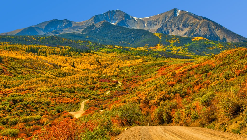 A rolling expanse of aspens, oaks, and pines create a panorama along West Sopris Creek Road near Aspen, Colorado.