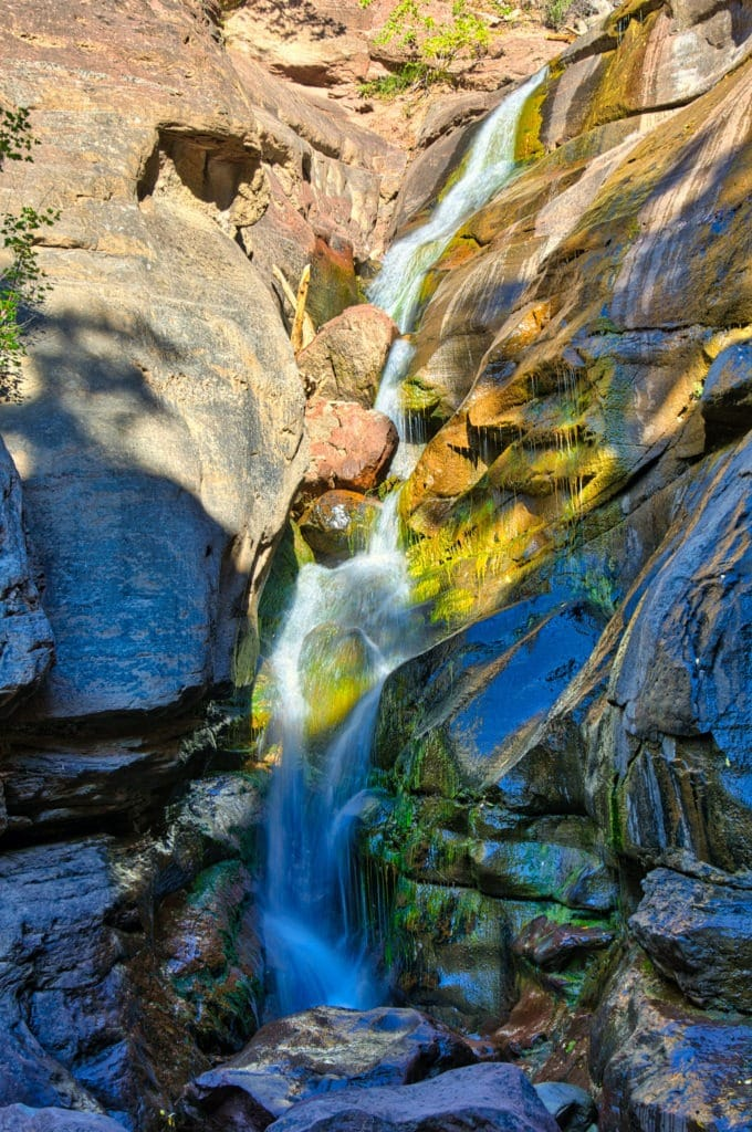 Hayes Creek Falls, off CO-133 near Redstone, Colorado, is especially colorful because of the variety of rocks and the wet mosses.
