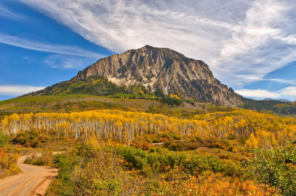 A view of golden aspens along Gunnison Country Road 12 below Marcellina Mountain, near Crested Butte, Colorado.