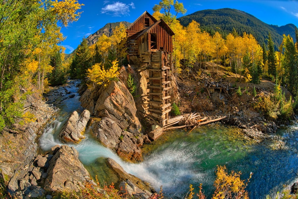 A wide-angle view of the old Crystal Powerhouse along the Crystal River near Marble, Colorado.