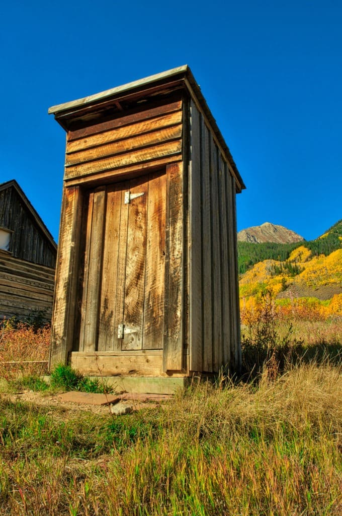 """An old privy stands along a """"street"""" in Ashcroft Ghost Town near Aspen, Colorado."""