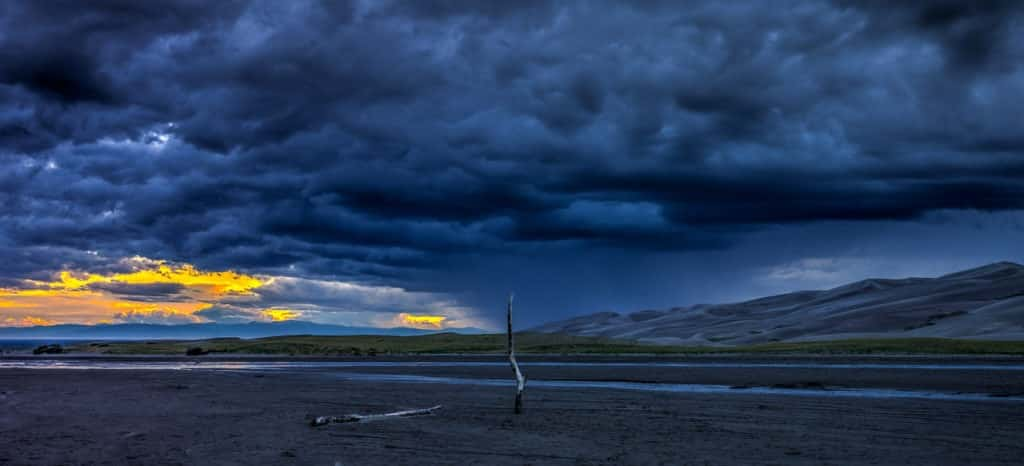 Sunset on Medano Creek in Great Sand Dunes National Park and Preserve.