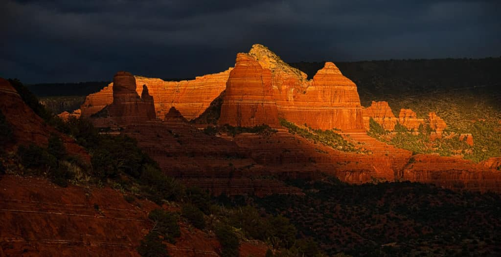 Thumb Butte (in shadow) and the Bench just before sunset in Sedona, Arizona.