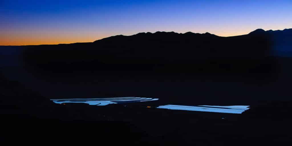 Predawn sky reflected in evaporative ponds of a potash mine southeast of Moab, Utah.