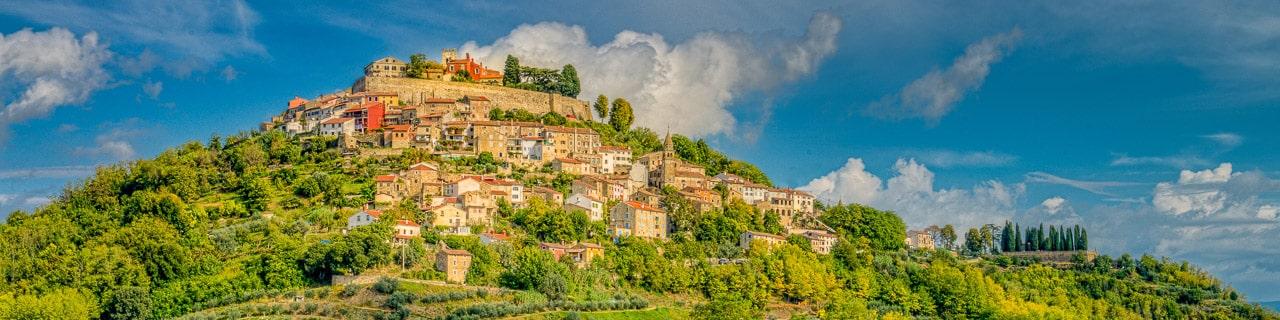 This panorama looks westward toward the hilltop Medieval Istrian village of Motovun, Croatia.