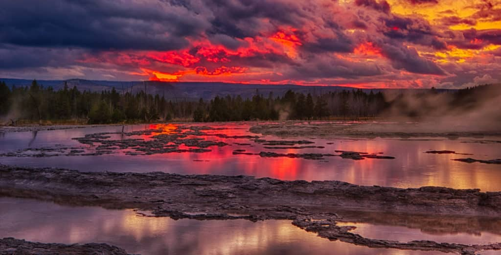 View of Great Fountain Geyser at sunset in Yellowstone National Park, Wyoming
