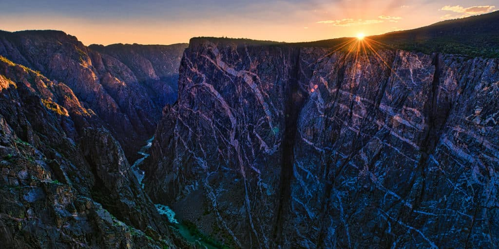A view of the Painted Wall at sunset in Black Canyon of the Gunnison National Park in Colorado from the Painted Wall View overlook.