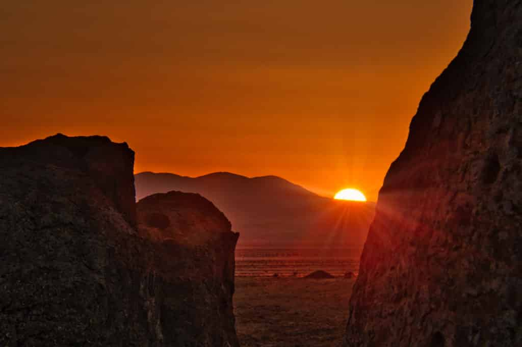 A dramatic sunset view taken through the eroded tuff pinnacles of City of Rocks State Park in New Mexico.