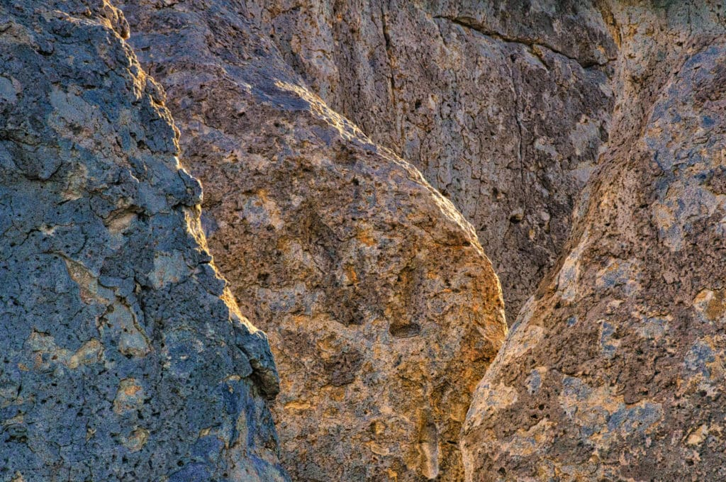 Subtle variations in the color of the Kneeling Nun Tuff are highlighted in this late afternoon closeup of overlapping fins and pinnacles in City of Rocks State Park, New Mexico.