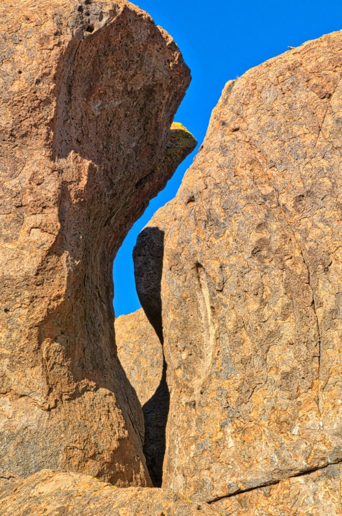 A shadow provides a sinuous component to this slit between two pinnacles giving the whole arrangement a sinuous quality. Taken in City of Rocks State Park between Deming and Silver City, New Mexico.