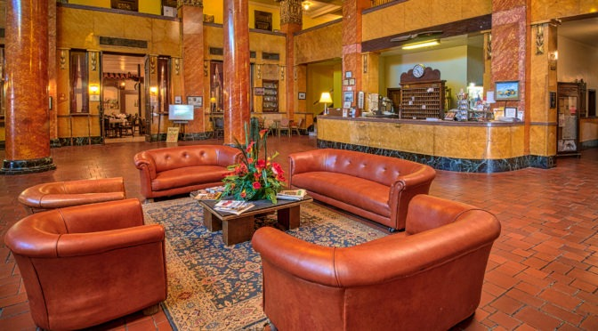 A View Of The Grand Gadsden Hotel Lobby Highlighting The Leather Furniture,  Tile Floors,