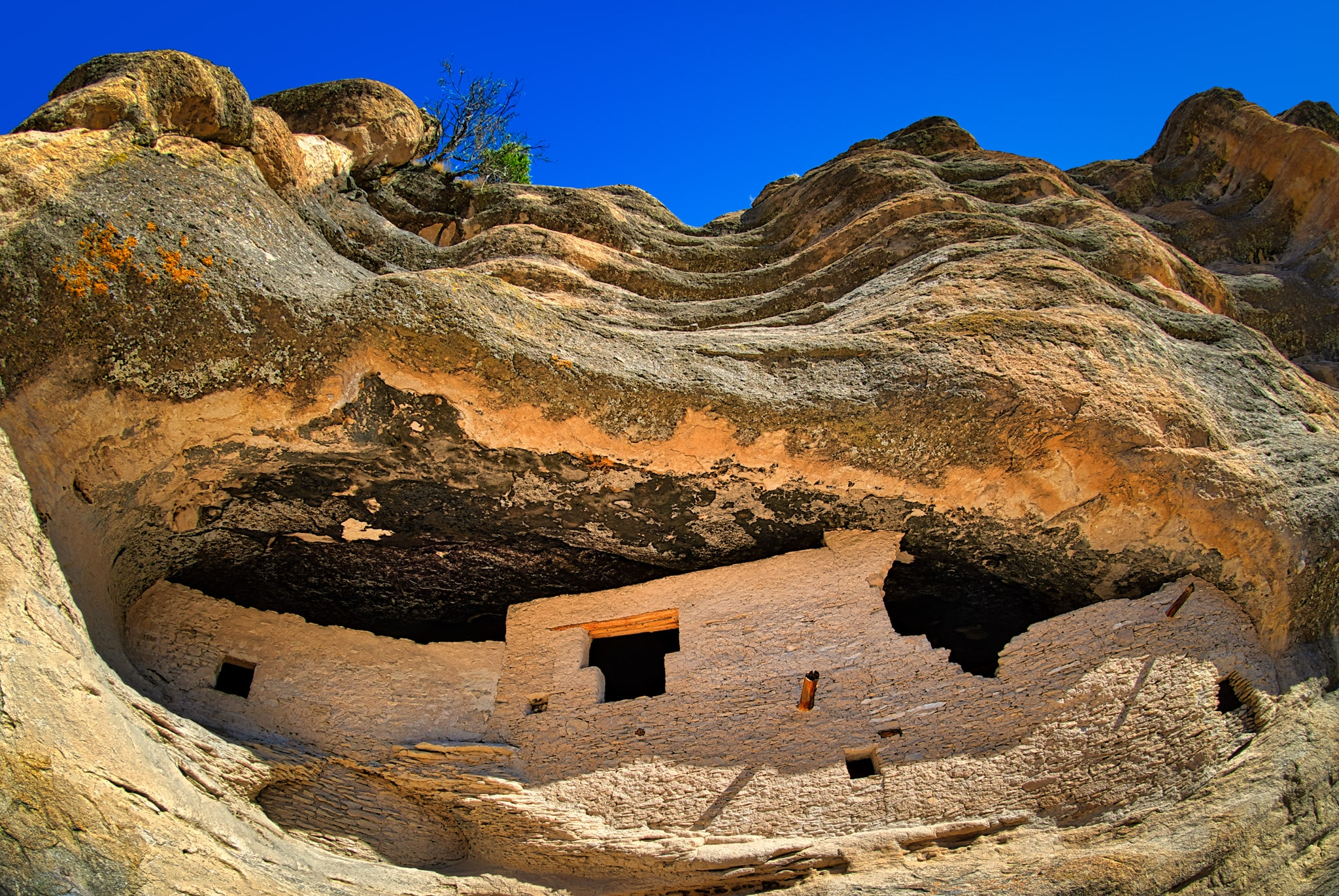 A fish-eye view looking up to the beautiful Gila Cliff Dwellings in Gila Cliff Dwellings National Monument near Silver City, New Mexico.