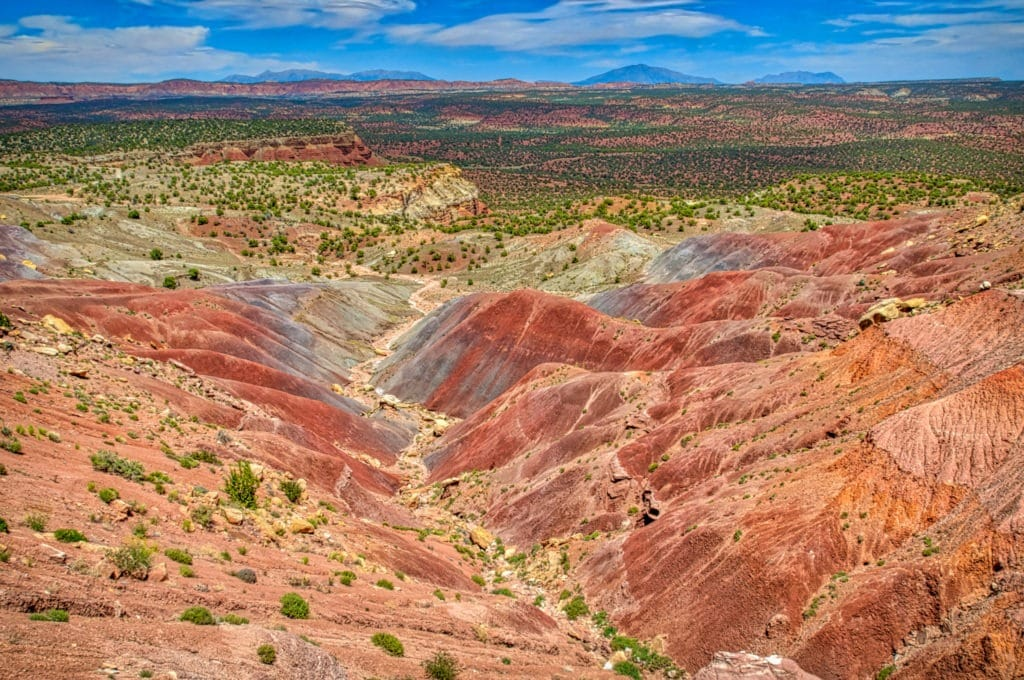 These badlands provide a colorful respite from the steep sandstone canyons farther east near Bullfrog, Utah, close to Capitol Reef National Park.