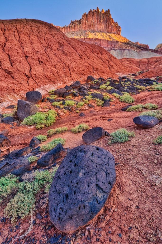 Basalt boulders along a wash descending from The Castle in Capitol Reef National Park, Utah.