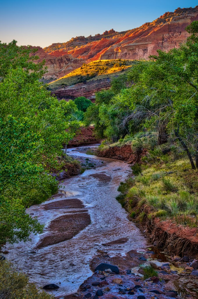 The first light catches the edges of cliffs above Sulphur creek just upstream of its junction with the Fremont River in Capitol Reef National Park.