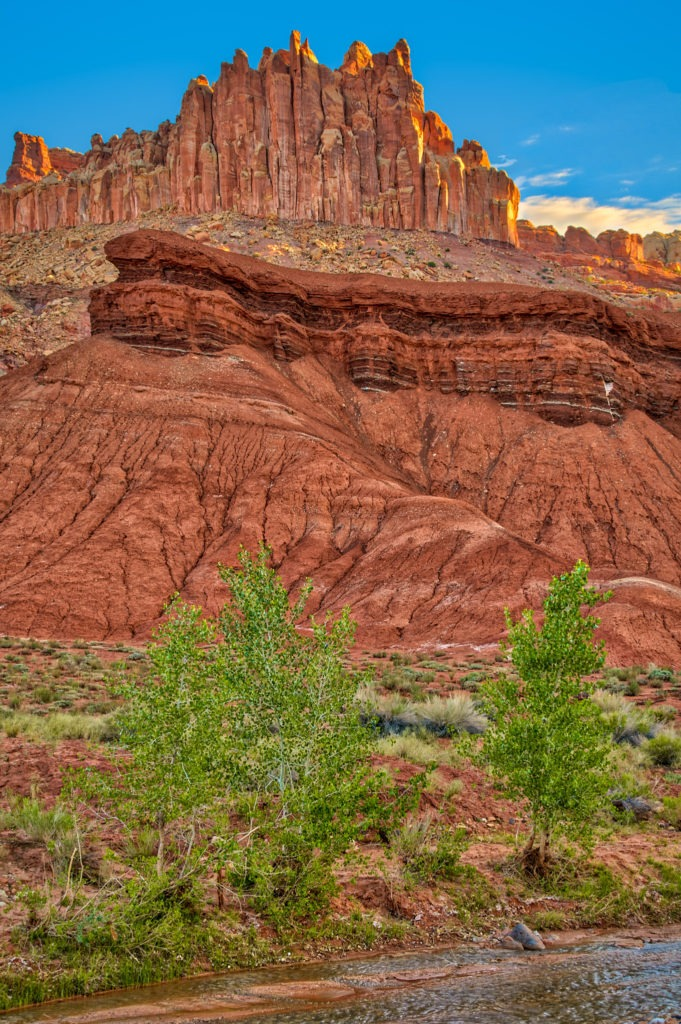 Along Utah Highway 24 near the Capitol Reef National Park Visitor Center, you can see layers of vari-colored rock formations, including the Chinle Formation, in a feature called The Castle.