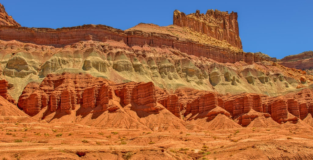 This is a view of the stratified rock formations along Utah State Route 24 in Capitol Reef National Park. From this vantage point, you can see the Moenkopi, Chinle, and Wingate Formations.