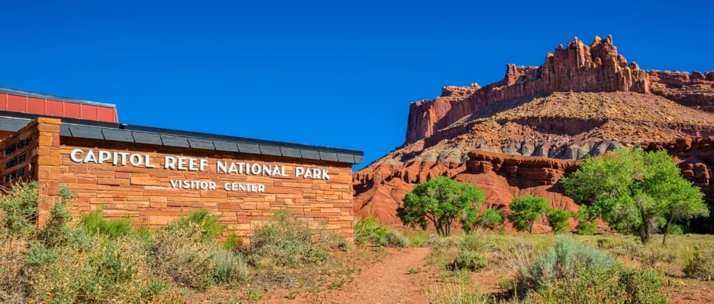 The Capitol Reef National Park Visitor Center is located off Utah State Route 24, just below The Castle, a sandstone rock formation.