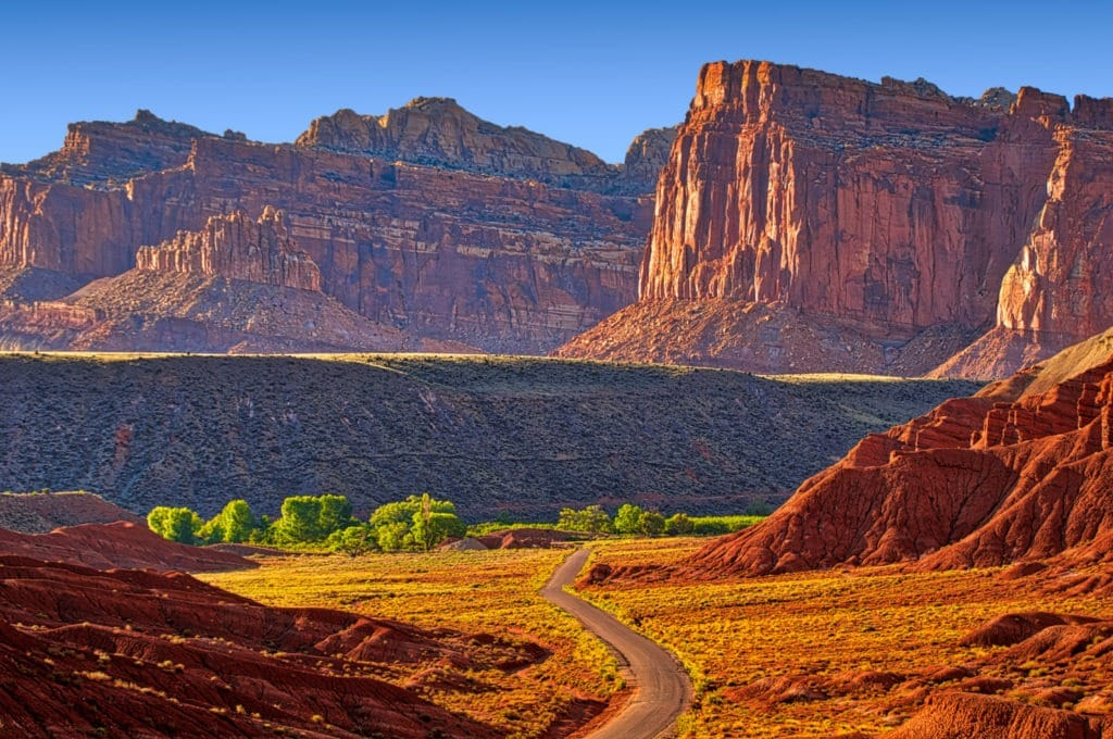 The afternoon light enhances the rich colors of the Moenkopi, Chinle, Wingate, and Navajo formations, as seen from Scenic Drive, south of Fruita in Capitol Reef National Park, Utah.
