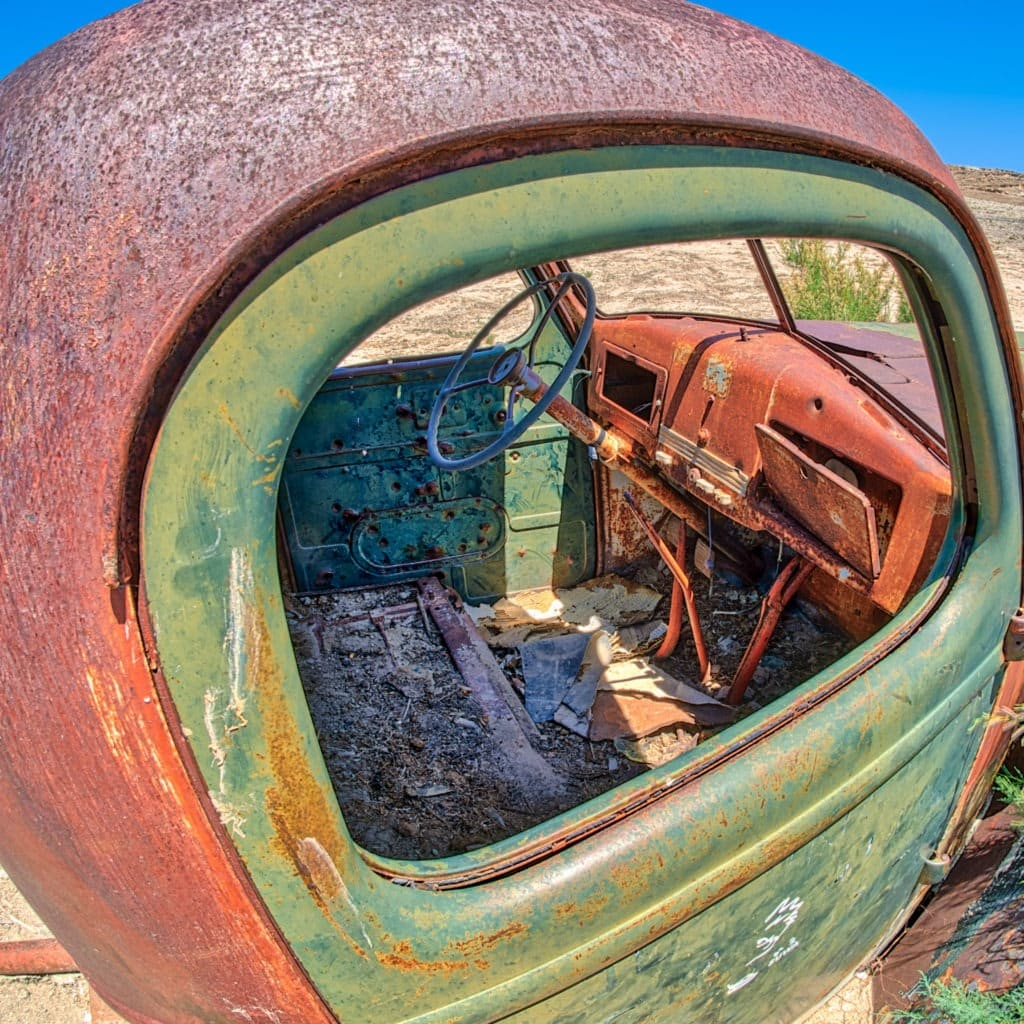 Bullet riddled cab of a water-drilling rig abandoned along Hartnet Road on the way to Cathedral Valley in Capitol Reef National Park, Utah.