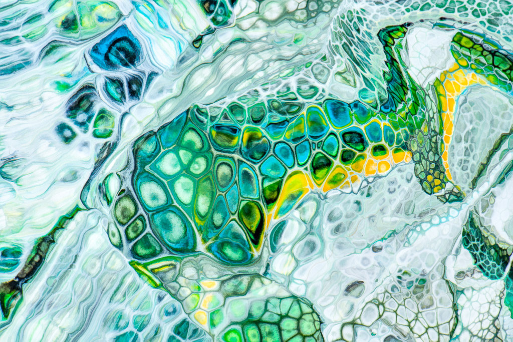 Abstract patterns made by mixing acrylic paints and fluorescent paint with oil and silicone, then photographing the results.