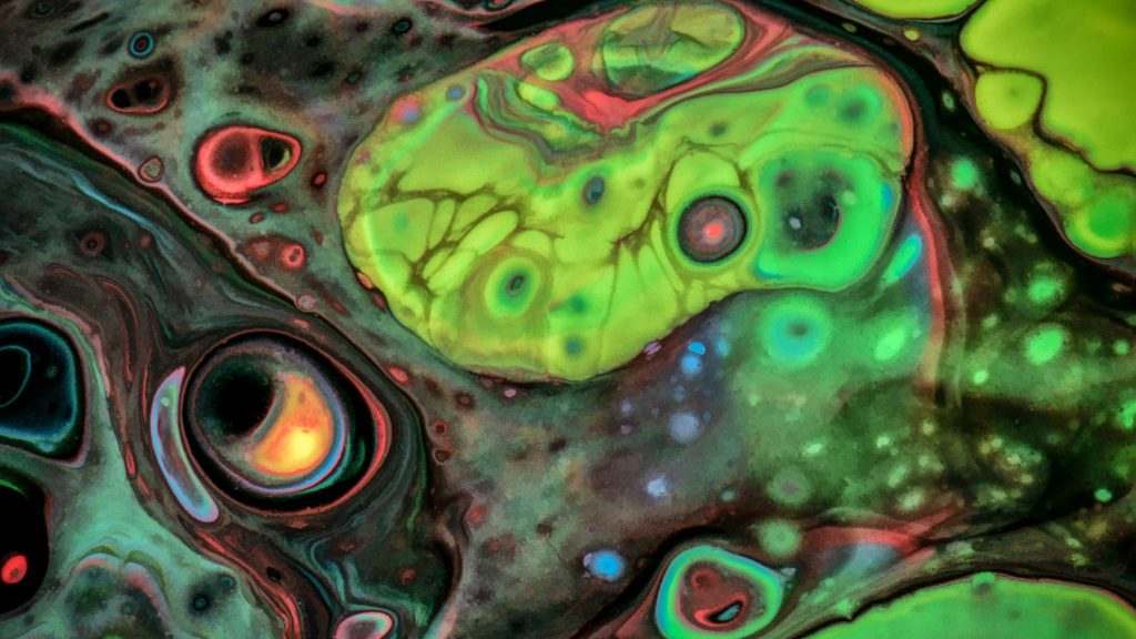 Swirling Paint Abstracts - Abstract patterns made by mixing acrylic paints and fluorescent paint with oil and silicone, then photographing the results. In the collection Colorful Abstract Close-ups.