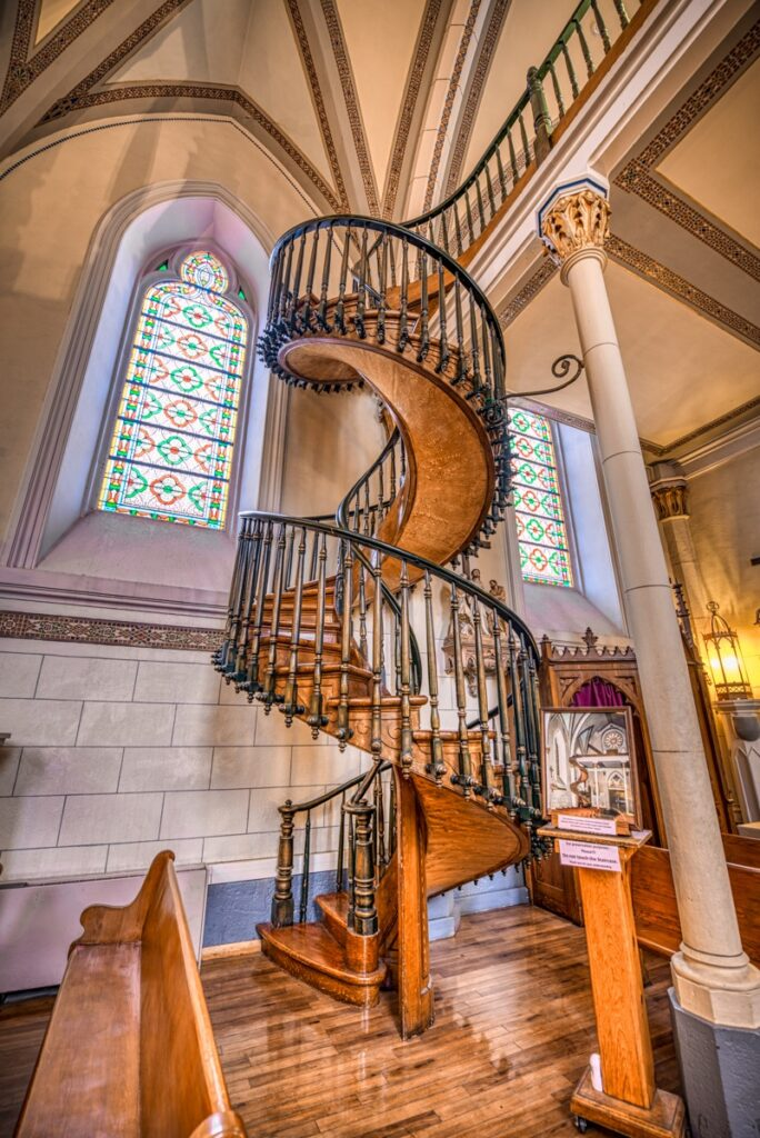 The Loretto Chapel is most famous for its spiral staircase. Many believers consider these spiral stairs to be miraculous; because, it is believed that they were constructed without the use of nails, glue or central support.
