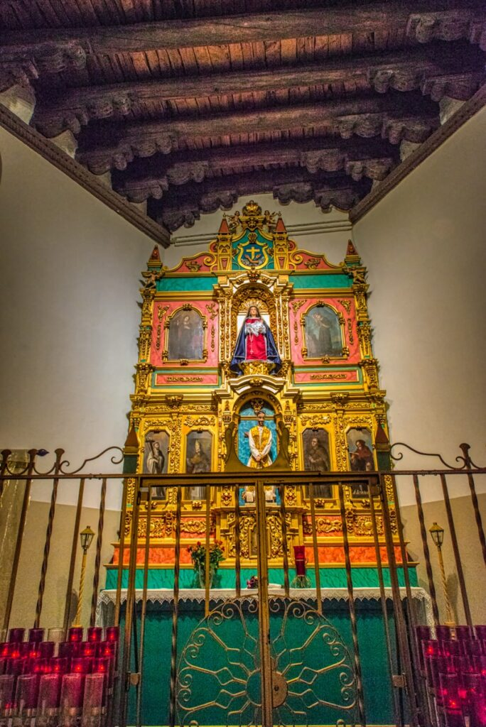 The Conquistadora Chapel, located to the left of the high altar, shows elements from La Parroquia. La Parroquia was built around 1714. The altar screen, or reredos, contains paintings brought from Spain in the 1700's. The staue of Our Lady of the Rosary, renamed La Conquistadora, dates from 1626 and the first church built on this site. This makes her the oldest Madonna in the United States. Below the Madonna is a representation of Christ wearing the Crown of Thorns, with a cross behind Him.