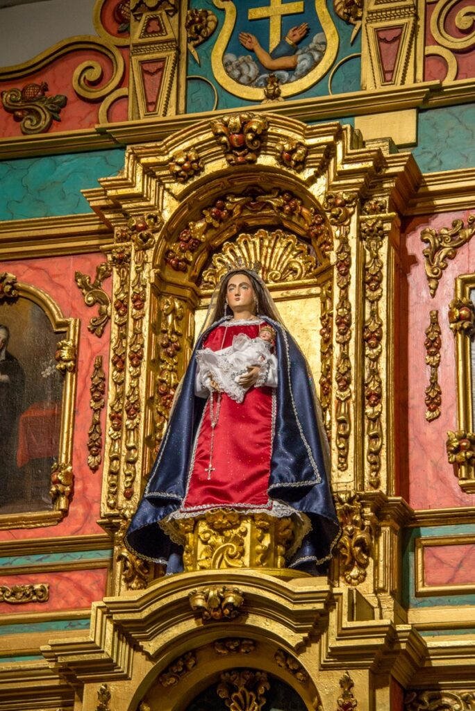 This close-up of La Conquistadora in the La Conquistadora Chapel, shows Her adorned in one of Her many vestments and rosaries. This staue of Our Lady of the Rosary, renamed La Conquistadora, dates from 1626 and the first church built on this site. This makes her the oldest Madonna in the United States.