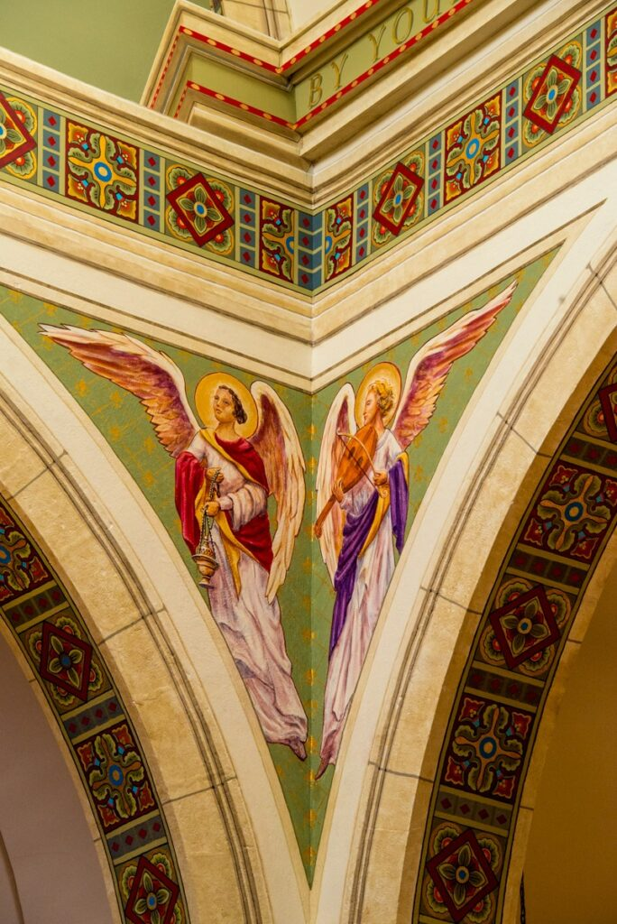 Two angels adorn the juxtaposition of two arches leading into the high altar in the apse of Sain Francis Cathedral in Santa Fe, New Mexico.