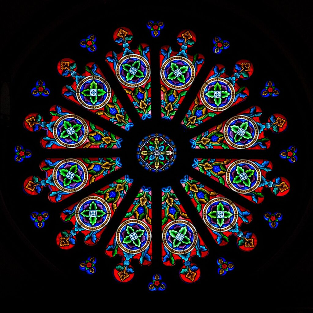 The large rose window, located in the narthex (or entrance) of the church, was imported from Clermont-Ferrand in France in the mid- to late-1800s.