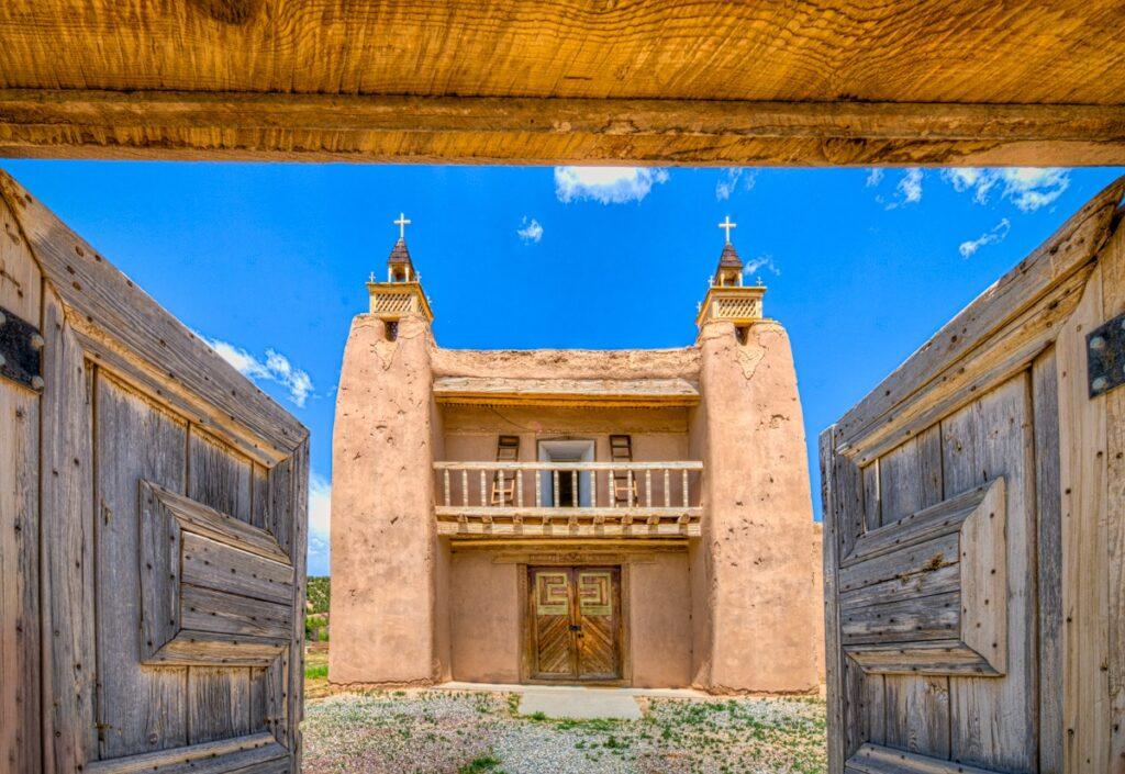 A view through the arched gateway at the front facade of the San Jose de Gracia church. The San Jose de Gracia Church, also known as Church of Santo Tomas Del Rio de Las Trampas, is a historic church on the main plaza of Las Trampas, New Mexico.