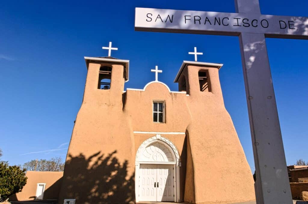 This is the front view of San Francisco de Asis Mission Church taken early on a late March morning. The church is located in Ranchos de Taos, New Mexico.