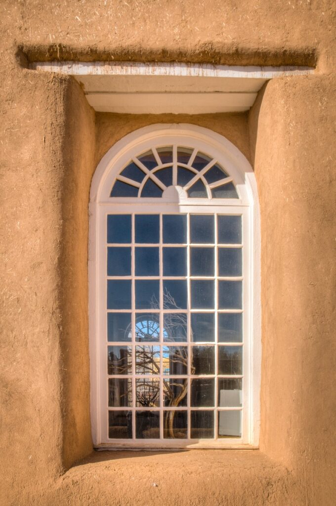 This is one of the windows in the sanctuary of San Francisco de Asis Mission Church in Ranchos de Taos, New Mexico.