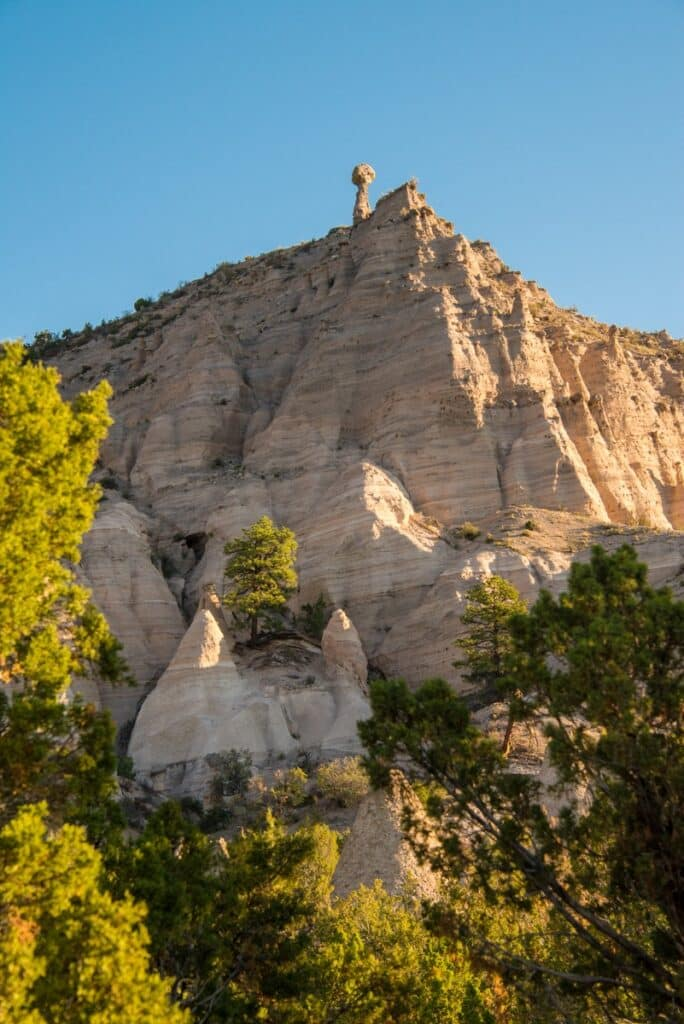 A lone hoodoo perches above the volcanic cliffs of Kasha-Katuwe Tent Rocks National Monument in northern New Mexico.