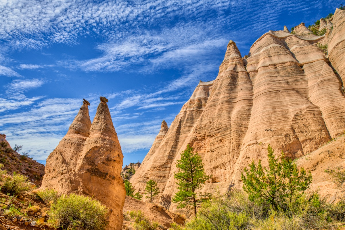 A view looking up at some of the tent-like formation eroded out of layers of ash, pumice, and tuff deposited by the eruptions of the Jemez volcanic field at Kashe-Katuwe Tent Rocks National Monument.