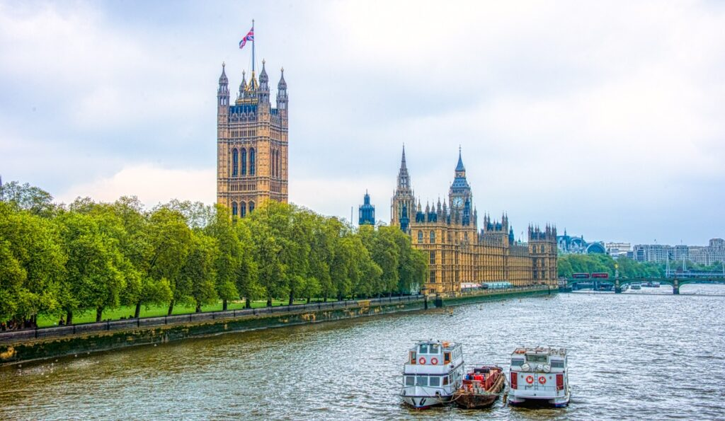 This is a view of the Palace of Westminster taken from the Lambeth Bridge, which crosses the Thames River. In the foreground is the Victoria Tower. In the Background is the top of Big Ben.