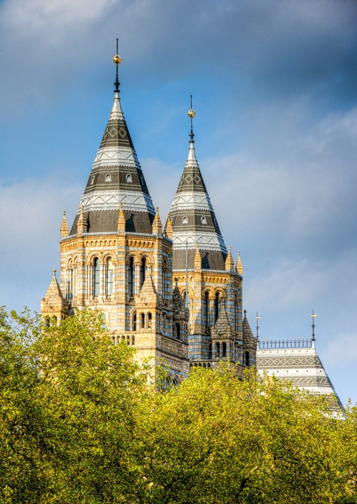 These massive, ornate towers flank the grand entrance to the Natural History Museum in London, England.