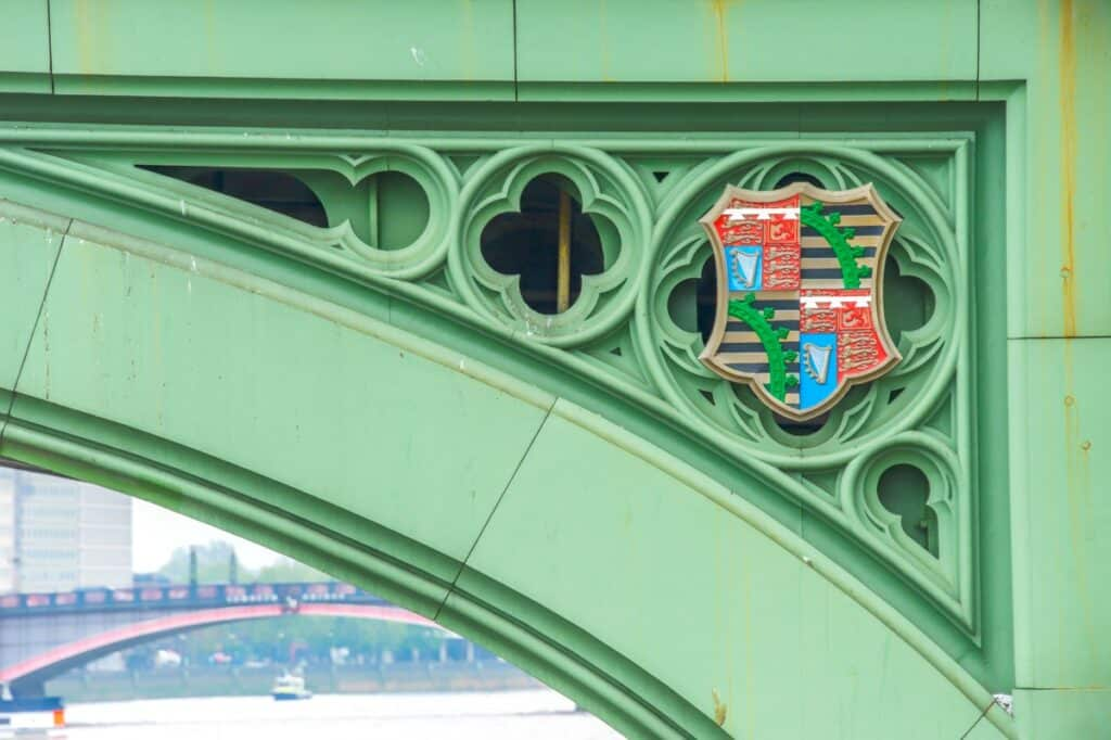 This detail of the Westminster Bridge shows Prince Albert's coat of arms. Through the bridge, at the lower left, you can see a portion of the Lambeth Bridge with its distinctive red paint.