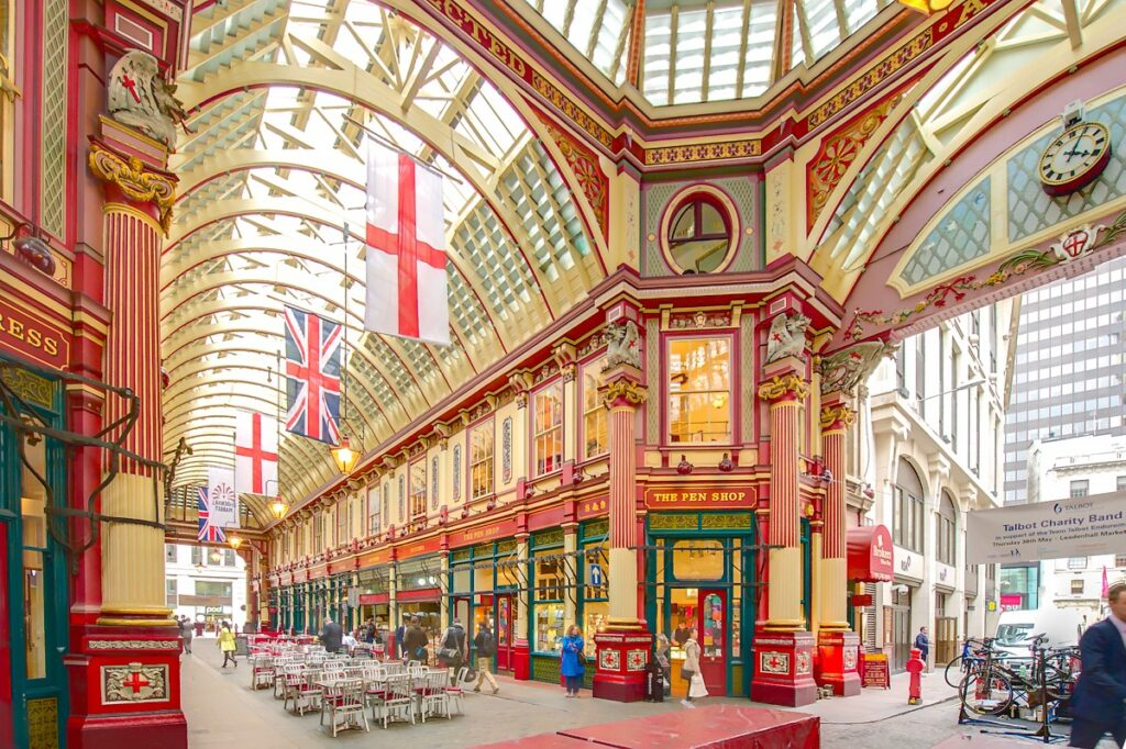 This view of Leadenhall Market was taken from the center of the structure. The ornate roof, painted green, maroon and cream, and cobbled floors of the current structure were designed in 1881 by Sir Horace Jones.
