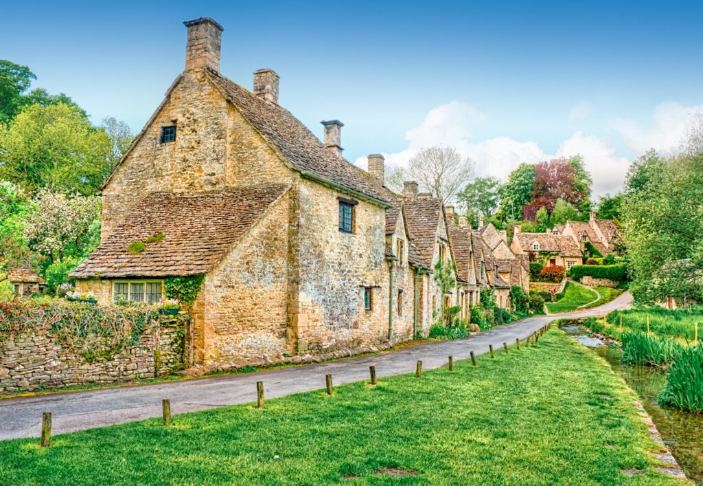 This National Trust property at Arlington Row, Bibury, Gloucestershire, is one of the most photographed areas in the Cotswolds. A scene similar to this one is depicted on the inside cover of all United Kingdom passports.