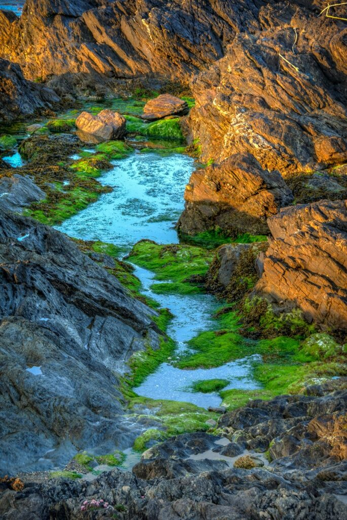 This is a closeup view of receding water along Fistal Bay near Newquay in Cornwall, England.