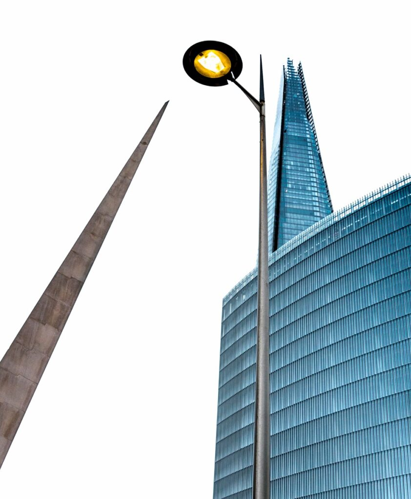 Here is a juxtaposition of the Needle Sculpture, a modern street lights and the Shard near London Bridge in London, England.