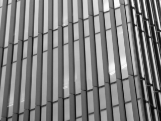 This is a closeup of the Price Waterhouse Coopers Building on Tooley Street near Tower Bridge in London. This image is part of our London architectural abstracts portfolio.