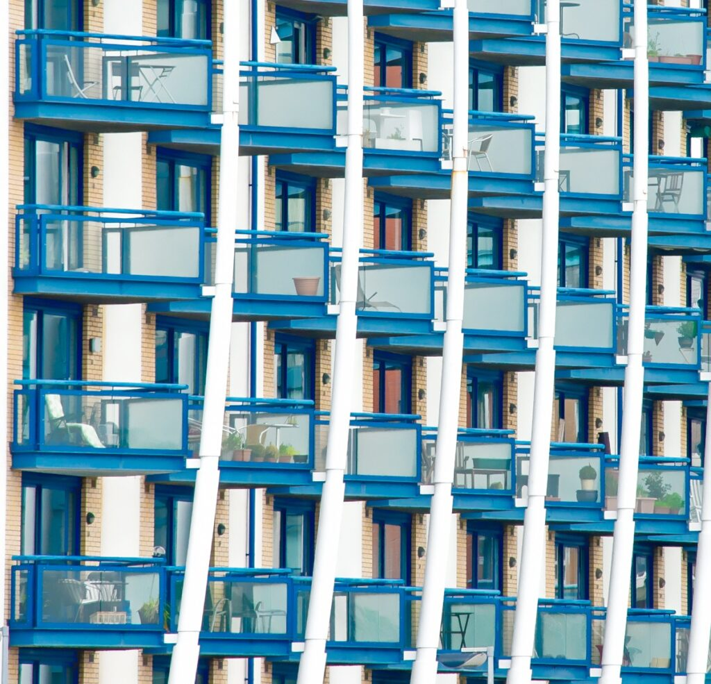 This is a detail of an apartment building along the Thames River taken from a ferry near South Dock Marina. This image is part of our London architectural abstracts portfolio.
