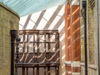 This view taken in the New Medieval And Renaissance Galleries. Among several facades in this gallery is the upper section of the Sir Paul Pindar House facase, dated to 1600. This photo appears in the Field Work: Landscape and Architecture exhibition at Black Box Gallery.